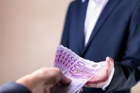 corruptible: Man in Mens Suits.Bribe and corruption with euro banknotes.