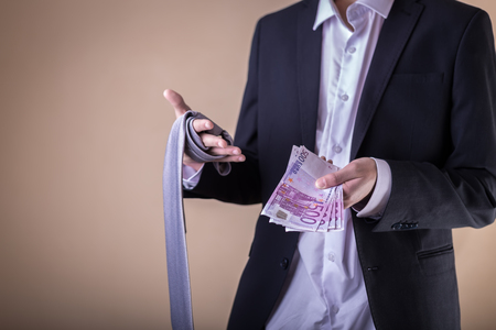 Man after party with banknotes. Gigolo with payment.