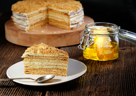 greek pot: Homemade honey cake according to the traditional recipe on the wooden background.