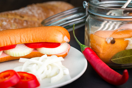 bred: Traditional Czech sausages (wurst) in vinegar with onion and hot pepper (chilli).