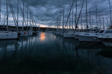 Sunrise in yacht harbor. Holidays on the Adriatic sea in Croatia. Stock Photo