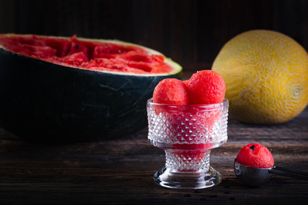 Balls made from fresh red watermelon in the cup.