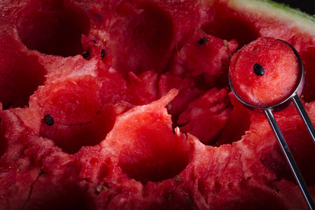 Cutting balls from fresh red watermelon with cutter. Stock Photo