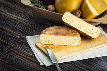 Homemade sheep and cows cheese from Romania. Farm products from rural areas. Reklamní fotografie