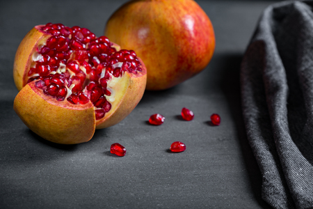 Sliced pomegranate with juicy red grains and  Reklamní fotografie