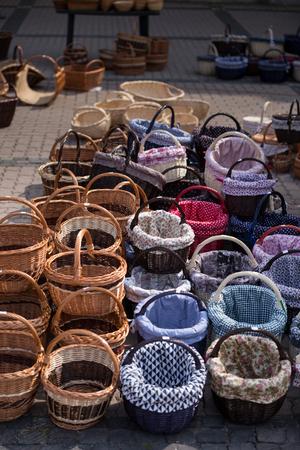 Various hand-knit baskets on the tradutional market. Reklamní fotografie