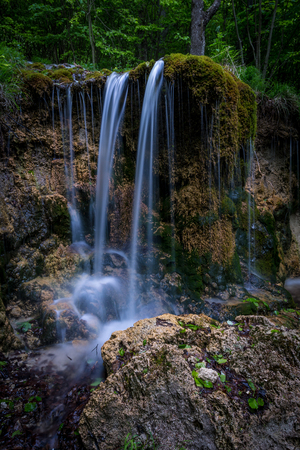 A wild waterfall in the middle of the mountains of central Europe, Mostenica, Slovakia.