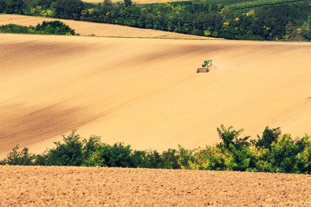 Tractor prepare field for a next season. Niederosterreich.