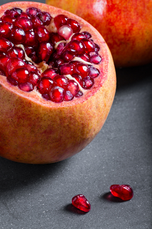 Sliced pomegranate with juicy red grains.
