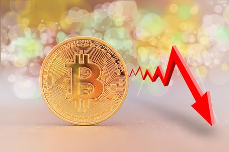 Bitcoin coin with a decreasing trend graph. Red arrow. Bitcoin value decreases.  Reklamní fotografie