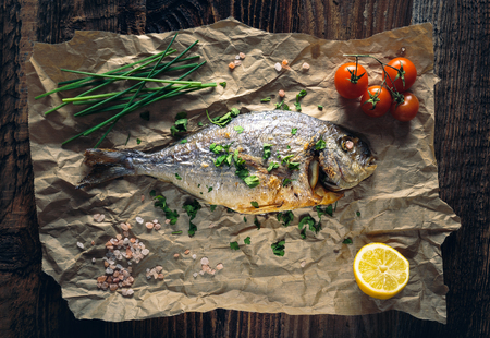 Gilthead seabream (Sparus aurata) baked in the oven with lemon, chive and salt.