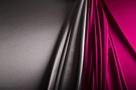 Shiny silver and wine - red   satin curved in various lines.