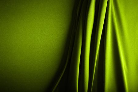 Shiny green satin curved in various lines Reklamní fotografie