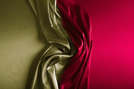 Shiny silver and wine red satin curved in various lines.