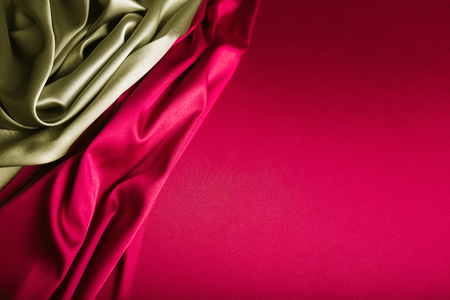 Shiny gold and wine red satin curved in various lines