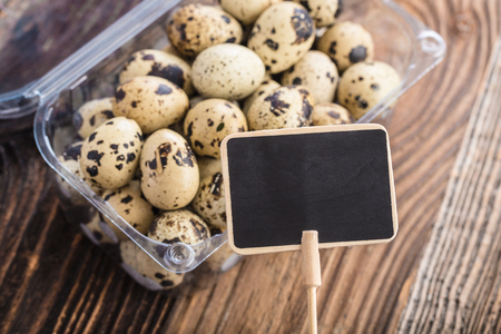 Organic quail eggs with prize tag. Natural gourmet meal.