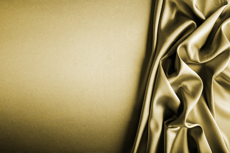 Shiny gold satin curved in various lines