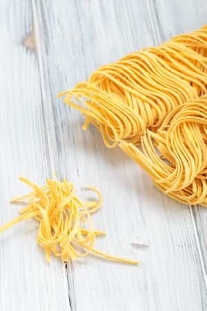 Fresh homemade Italian pasta on a table Reklamní fotografie