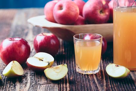 Fresh organic apple cider or apple juice on the old a wooden table. Reklamní fotografie