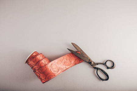 Decorative ribbon and old tailors scissors. Packing of Christmas presents. Reklamní fotografie