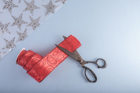 Decorative ribbon and old tailors scissors. Christmas craft supplies.