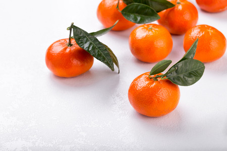 Fresh tangerines on a white background. Juicy mandarins with green leaves Stok Fotoğraf