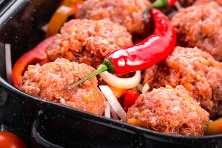 Detail homemade meatballs with sauce. Minced meat and vegetables.