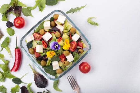 Bowl of vegetable salad with edible flowers. Top view. Stok Fotoğraf