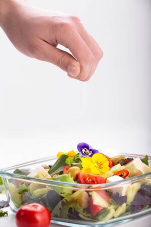 Bowl of vegetable salad with edible flowers. Stok Fotoğraf