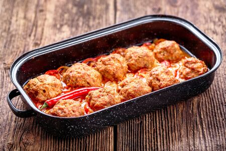 Homemade meatballs with sauce. Minced meat and vegetables.