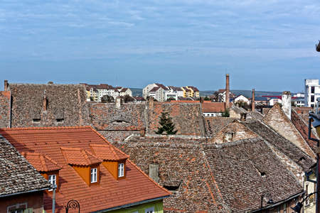 architectural tradition: Old roofs and the new one in Old Town Sibiu Romania view from Liars Bridge