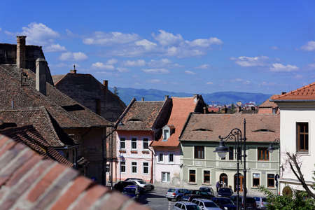 architectural tradition: Lower Town Sibiu Romania View from Dog Back aka Centumvirilor street on blu sky Editorial