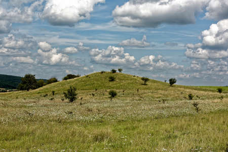 Herd of clouds on the sky mysterious mound near Nucet Sibiu county Romania