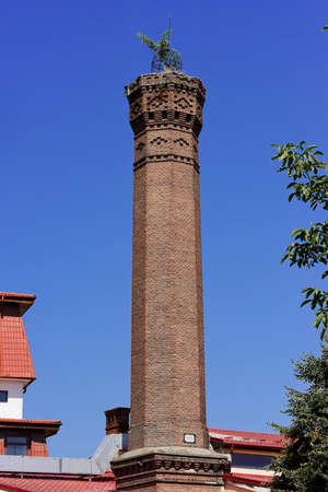 Tower brick Chimney dated 1888 Sibiu Romania in the midle of Sibiu town Stock Photo