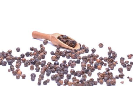 piperine: Black peppercorn isolated on white background Stock Photo