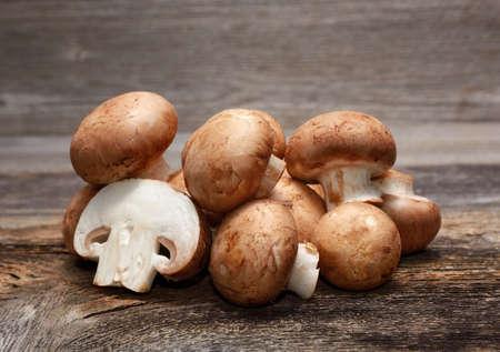 agaricus: champignon on wooden background