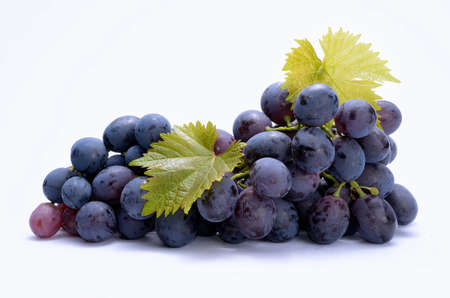 Red grapes with leaveas isolated on white background