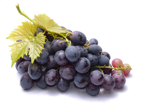 grapes: Red grapes with leaveas isolated on white background