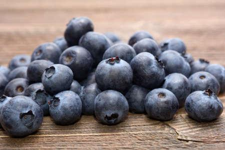 Blueberries on wooden table Standard-Bild