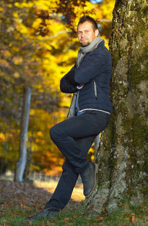 jungle boy: Young man in the autumn forest Stock Photo