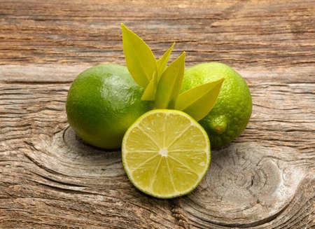 Fresh limes on wooden background Standard-Bild