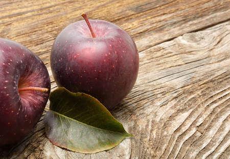 stark: Stark apples on wooden background