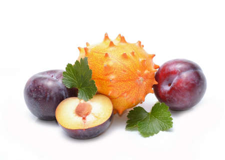 pulpy: Plums and kiwano fruit Stock Photo