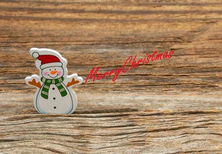merry chrismas: Snowman on wooden background. Merry Chrismas Stock Photo