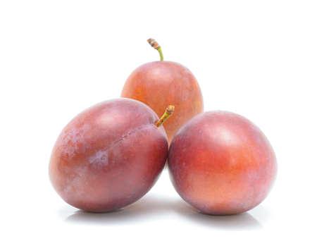 rakia: plums isolated on the white background Stock Photo