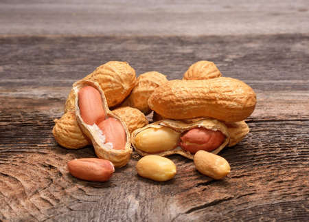 Peanuts on wooden background Stock Photo