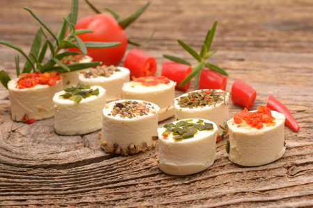 Feta cheese cubes with rosemary twig