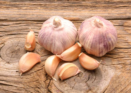 spiciness: Garlic on the wooden background Stock Photo