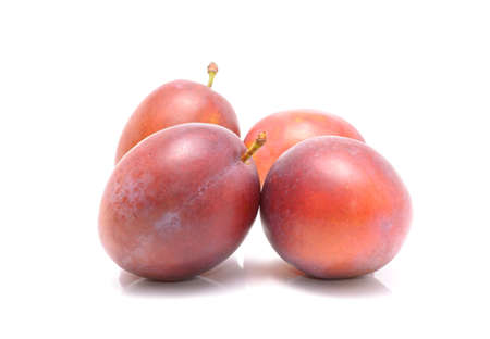Plums isolated on the white background Foto de archivo