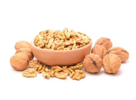 Raw walnuts on white background
